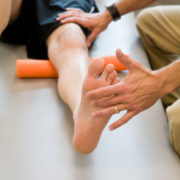 This is patient and physical therapist duing leg lifts.